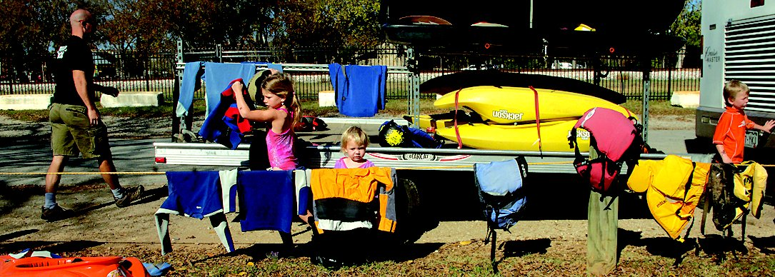 The family's water recreation gear travels in a trailer behind their RV.