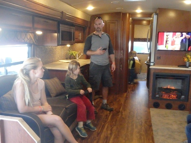 Dynamax RV - huge workstation behind Dan! Perfect for working on the road!