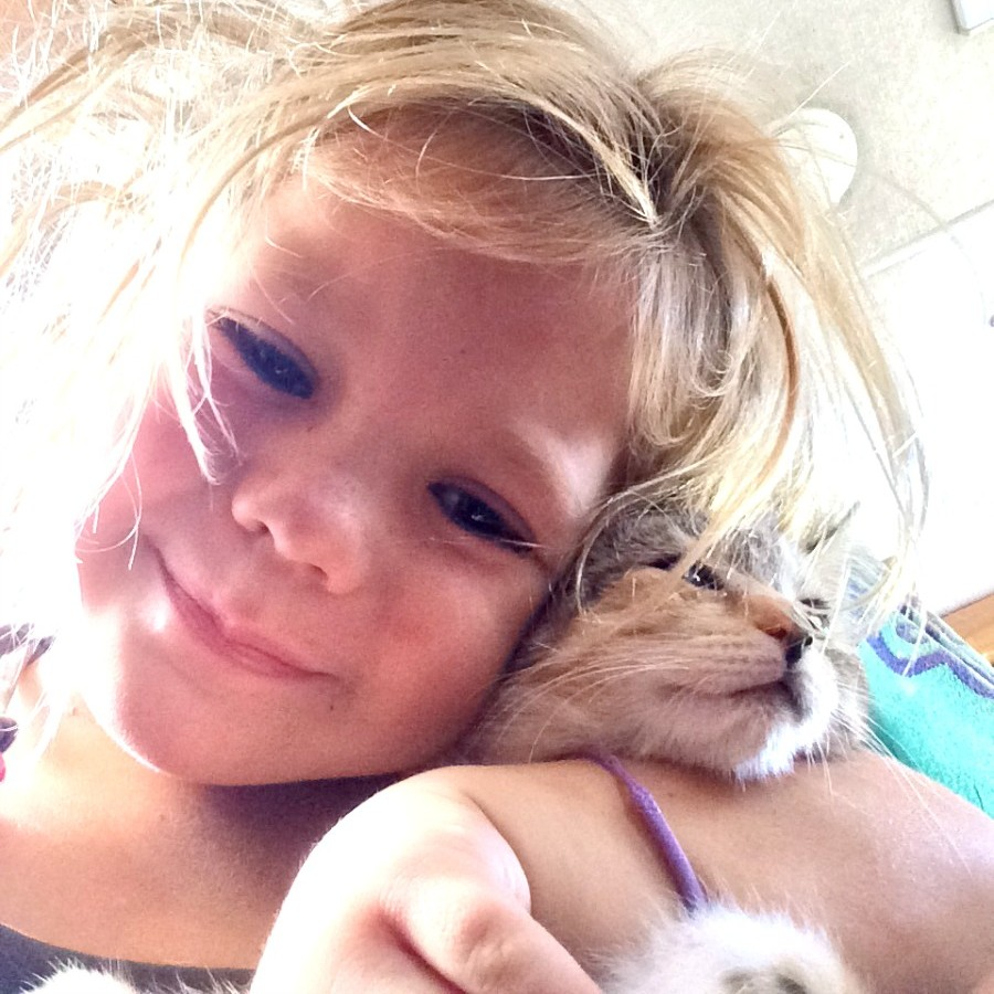 Elly Hugging a Kitten