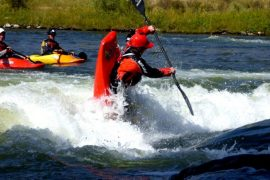 Kids Kayaking in the fall in Colorado