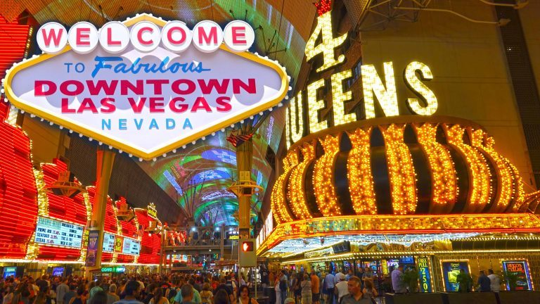 Find a cozy spot to sit and take in the sights and sounds of Fremont St could very well be one of the most Romantic Things To Do In Las Vegas!